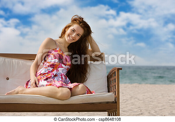 young smiling woman on sea background - csp8648108