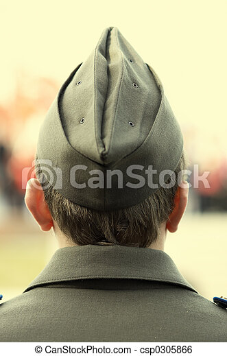 young soldier in field cap focusing point on back of the head - csp0305866