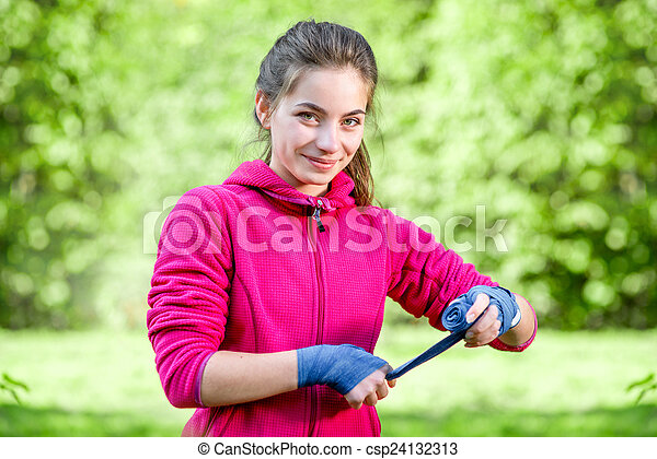 Young sports woman in the park  - csp24132313