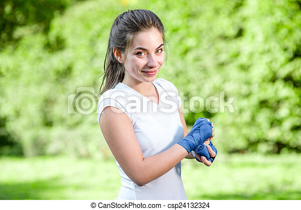 Young sports woman in the park  - csp24132324