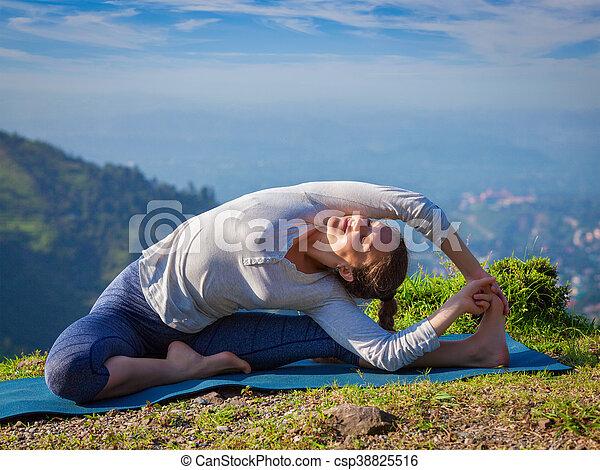 young sporty fit woman doing hatha yoga asana yoga