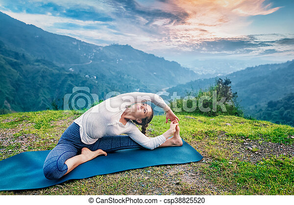 young sporty fit woman doing hatha yoga asana in mountains
