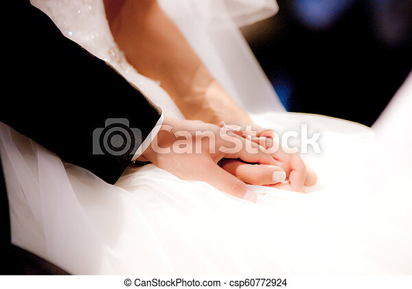 young spouses play with love rings that they have given themselves - csp60772924