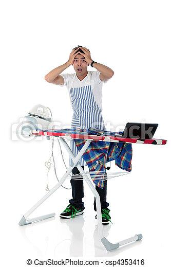 Young stressed Nepalese man, iron, laptop - csp4353416
