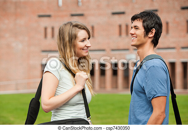 Young student couple flirting - csp7430350