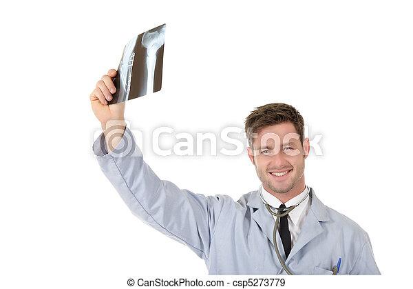 Young successful caucasian man doctor, xrays - csp5273779