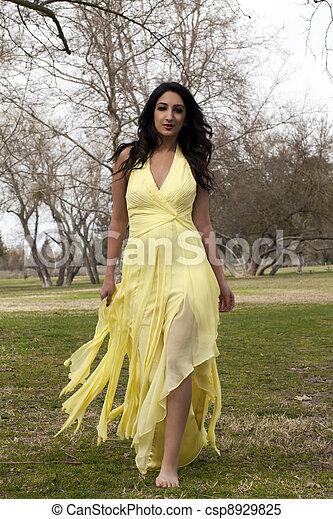 Young Teen East Indian Woman Yellow Dress - csp8929825