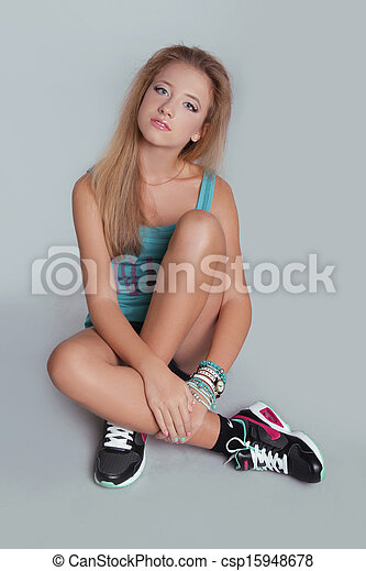 Young teen girl sitting with sporty sneakers shoes studio picture search photo clipart - Teen age girl picthar ...