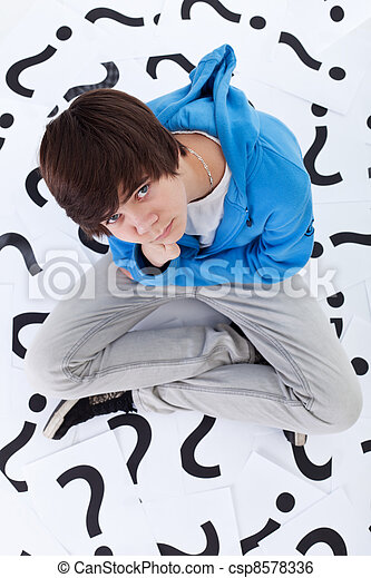 Young teenager boy with lots of questions - csp8578336
