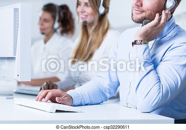 Young telemarketers in the office - csp32290611