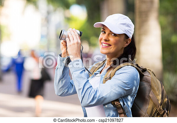 young tourist photographing in town - csp21097827