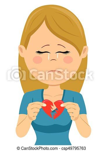 Young unhappy sad woman with a broken heart card - csp49795763