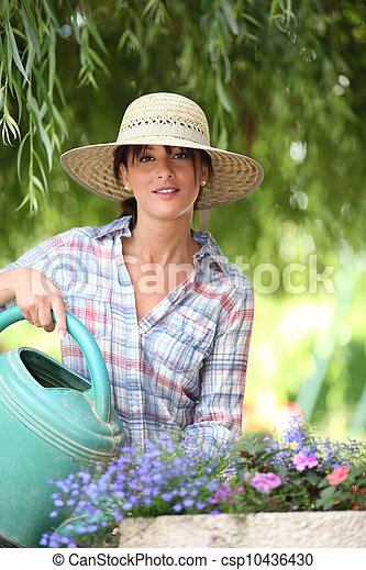Young watering flowers - csp10436430