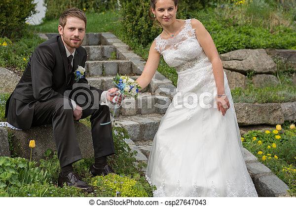 Young wedding couple in garden - csp27647043