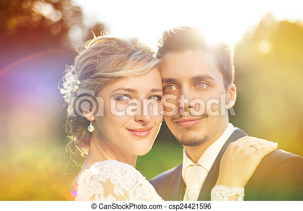 Young wedding couple on summer meadow - csp24421596