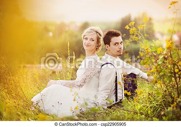 Young wedding couple on summer meadow - csp22905905