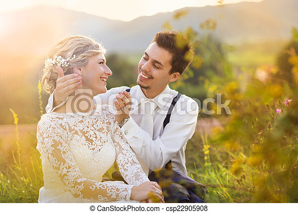 Young wedding couple on summer meadow - csp22905908