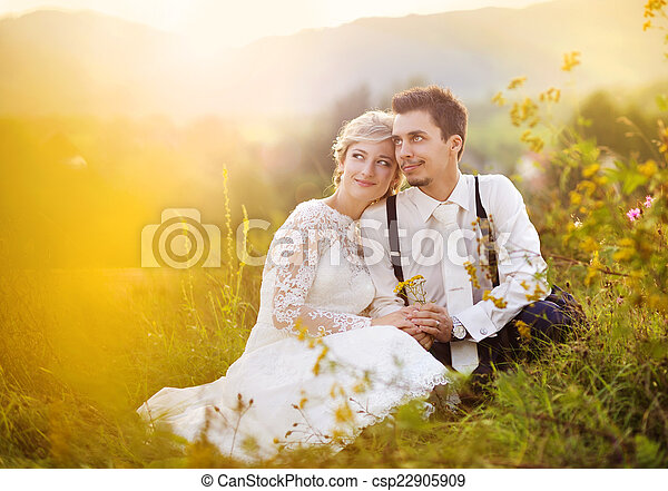 Young wedding couple on summer meadow - csp22905909
