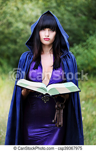 young witch with a book - csp39367975