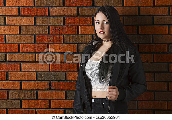 Young woman against a wall - csp36652964