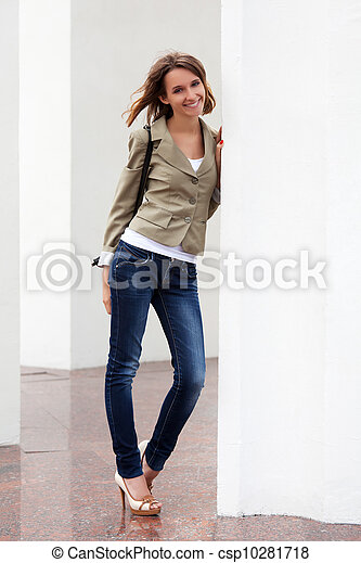 Young woman against a white wall - csp10281718
