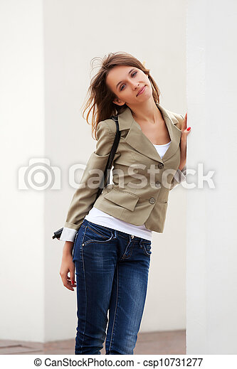 Young woman against a white wall - csp10731277