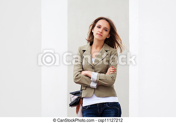 Young woman against a white wall - csp11127212