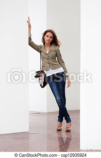 Young woman against a white wall - csp12935924