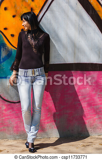 Young woman against wall - csp11733771