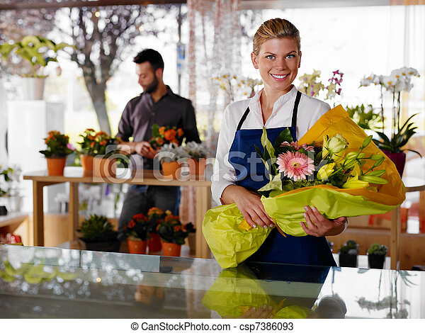 Young woman and client in flowers shop - csp7386093