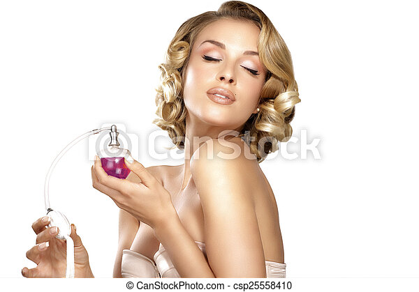 Young woman applying perfume on her neck space for text - csp25558410