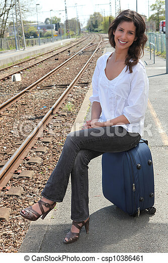 young woman at a train station - csp10386461