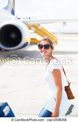 Young woman at an airport - csp12596356