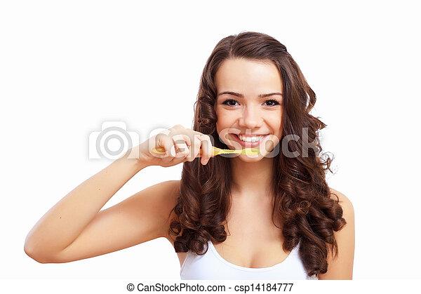 Young woman at home brushing teeth - csp14184777