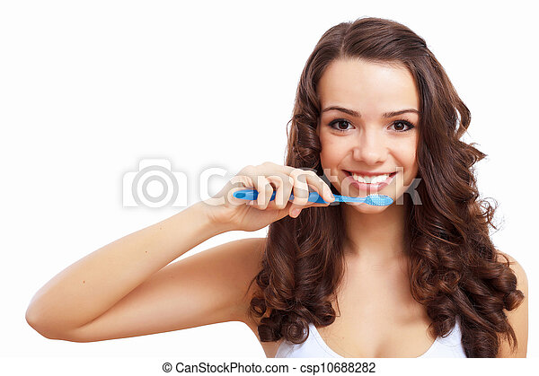 Young woman at home brushing teeth - csp10688282