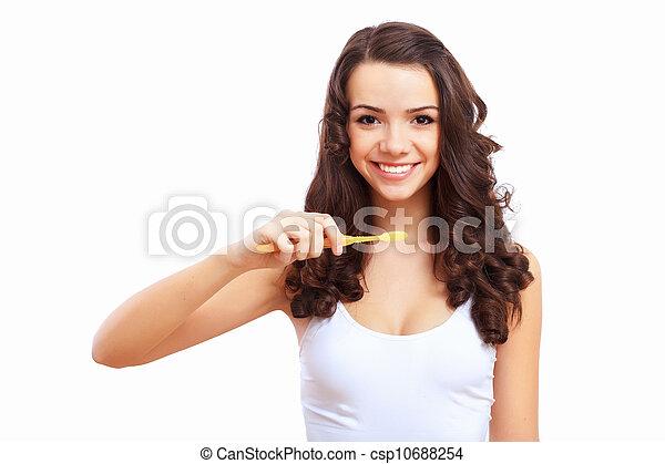Young woman at home brushing teeth - csp10688254