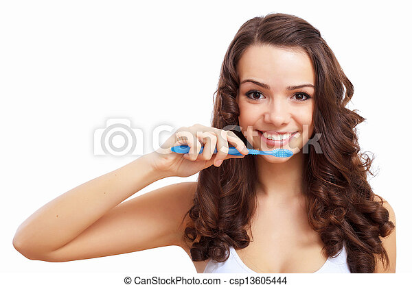 Young woman at home brushing teeth - csp13605444