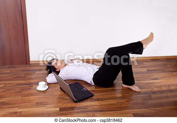 Stock Photo   Young Woman Barefoot Relaxed On The Floor