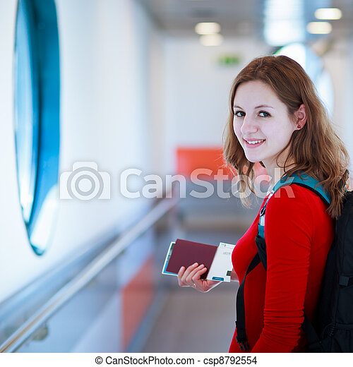 young woman  boarding an aircraft - csp8792554