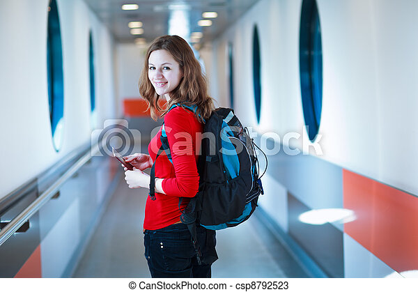 young woman  boarding an aircraft - csp8792523