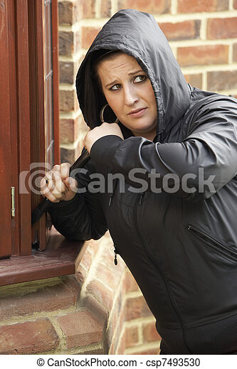 Young Woman Breaking Into House - csp7493530