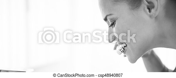 Young woman brushing teeth - csp48940807