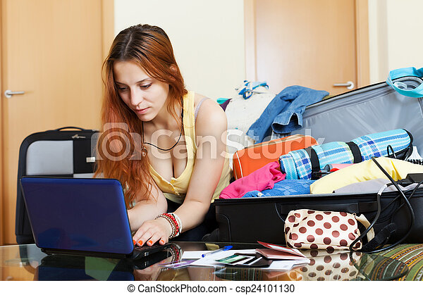 Young woman buying tickets online - csp24101130