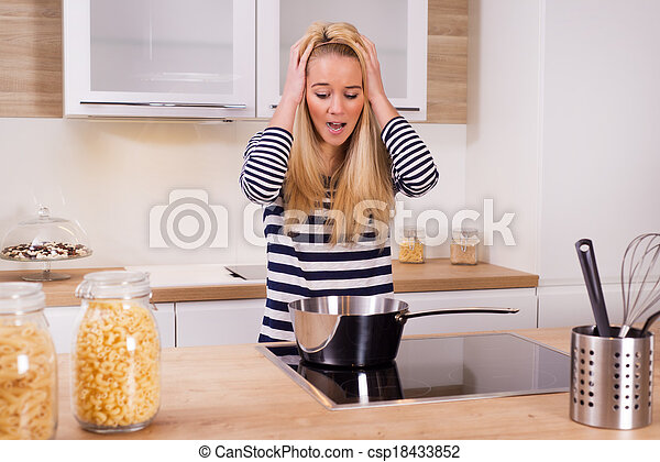 Young woman cooking dinner - csp18433852