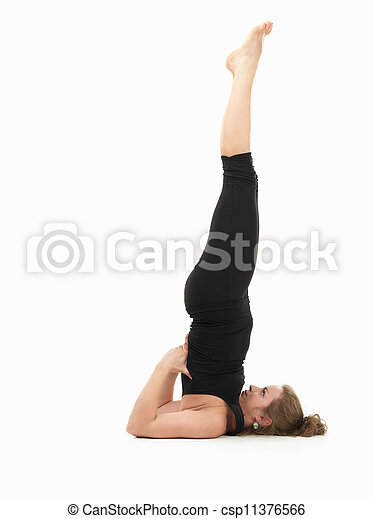 young woman demonstrating difficult yoga pose