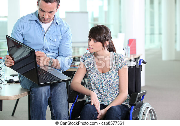 Young woman disabled with co-worker - csp8577561