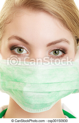 Young woman doctor in face surgical mask - csp30150930