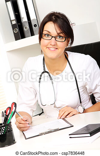 Young woman doctor in her office - csp7836448