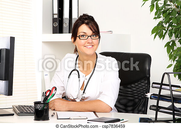 Young woman doctor in her office - csp7836459