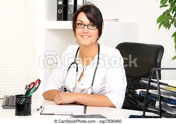 Young woman doctor in her office - csp7836460